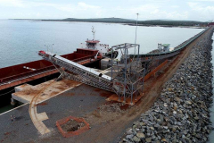 Ore conveyed along causeway and onto barge